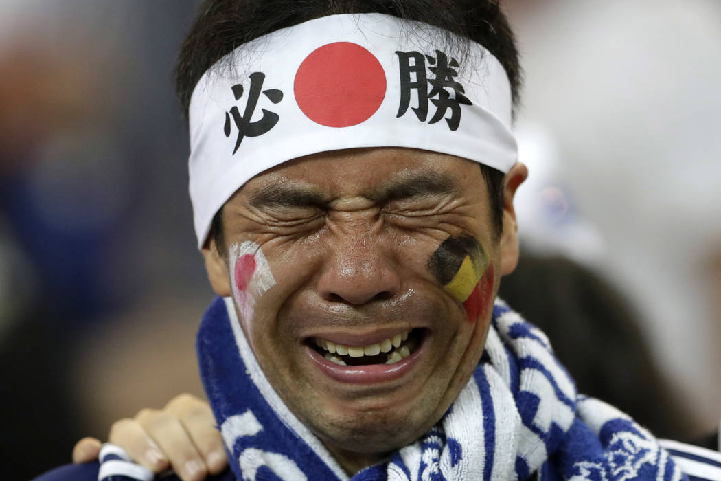 A Japan supporters cries after losing the round of 16 match between Belgium and Japan at the 2018 soccer World Cup in the Rostov Arena, in Rostov-on-Don, Russia, Monday, July 2, 2018. (AP Photo/Pe ...