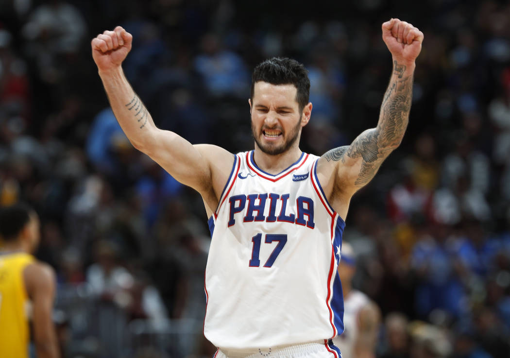 In this Dec. 30, 2017, file photo, Philadelphia 76ers guard JJ Redick celebrates in the final moments of a 107-102 win against the Denver Nuggets, in Denver.Redick is returning to the 76ers. (AP P ...