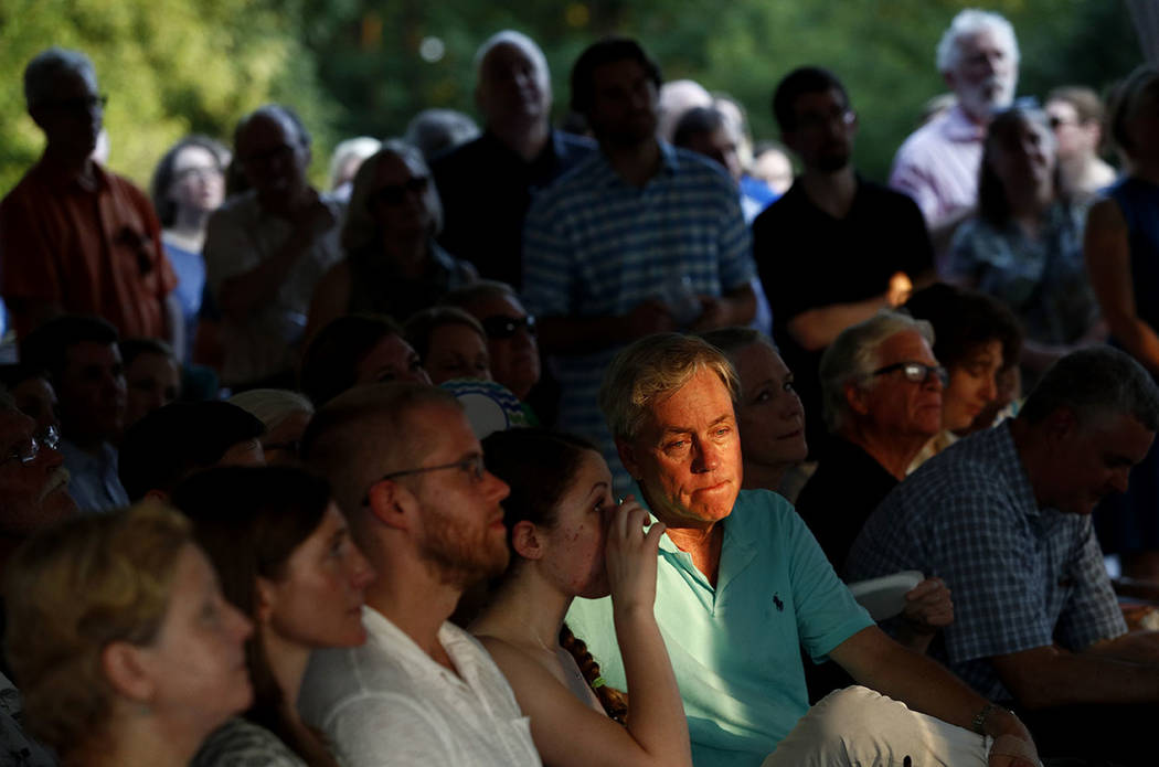 Sunlight falls on Carl Hiaasen, brother of Rob Hiaasen, one of the journalists killed in the shooting at the Capital Gazette newspaper offices, during a memorial service, Monday, July 2, 2018, in ...