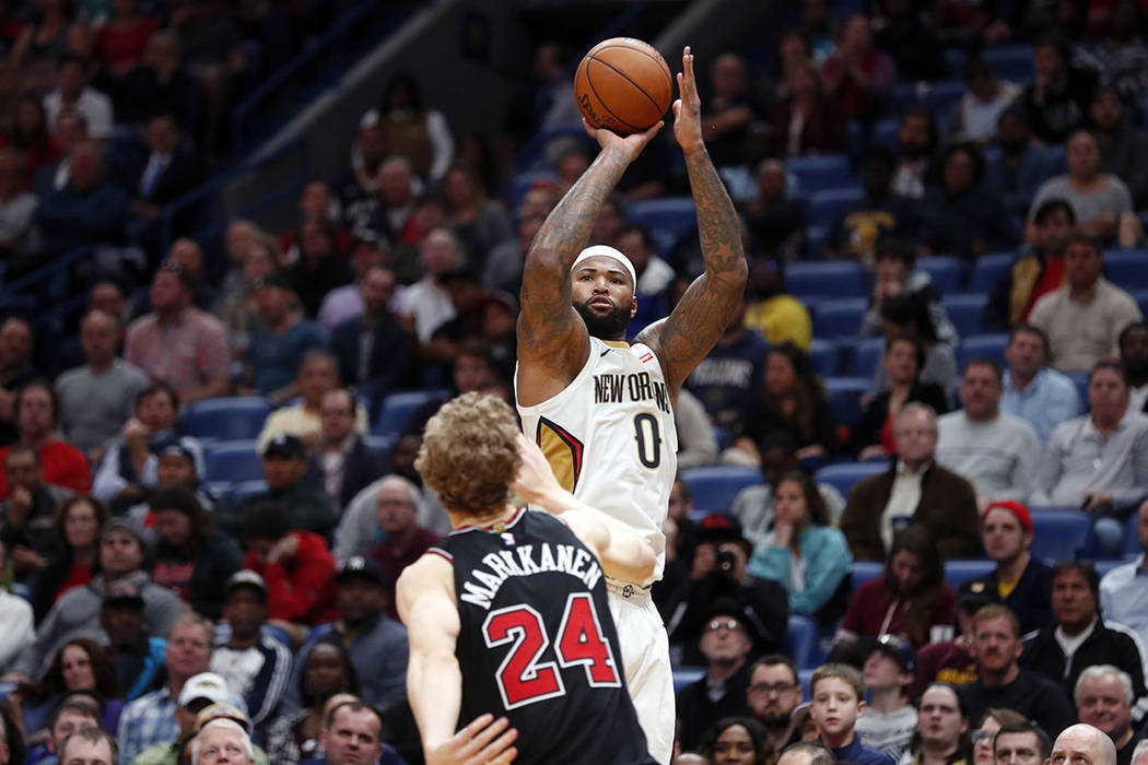 DeMarcus Cousins (0) shoots over Chicago Bulls forward Lauri Markkanen (24) in the second half of an NBA basketball game in New Orleans, Monday, Jan. 22, 2018. (AP Photo/Gerald Herbert)
