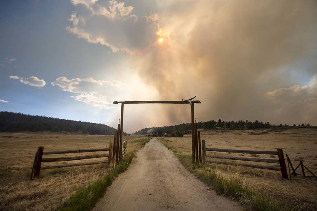 The Weston Pass Fire threatens homes along Highway 285, Monday, July 2, 2018, near Fairplay, Colo. In Colorado, more than 2,500 homes were under evacuation orders as firefighters battled more than ...