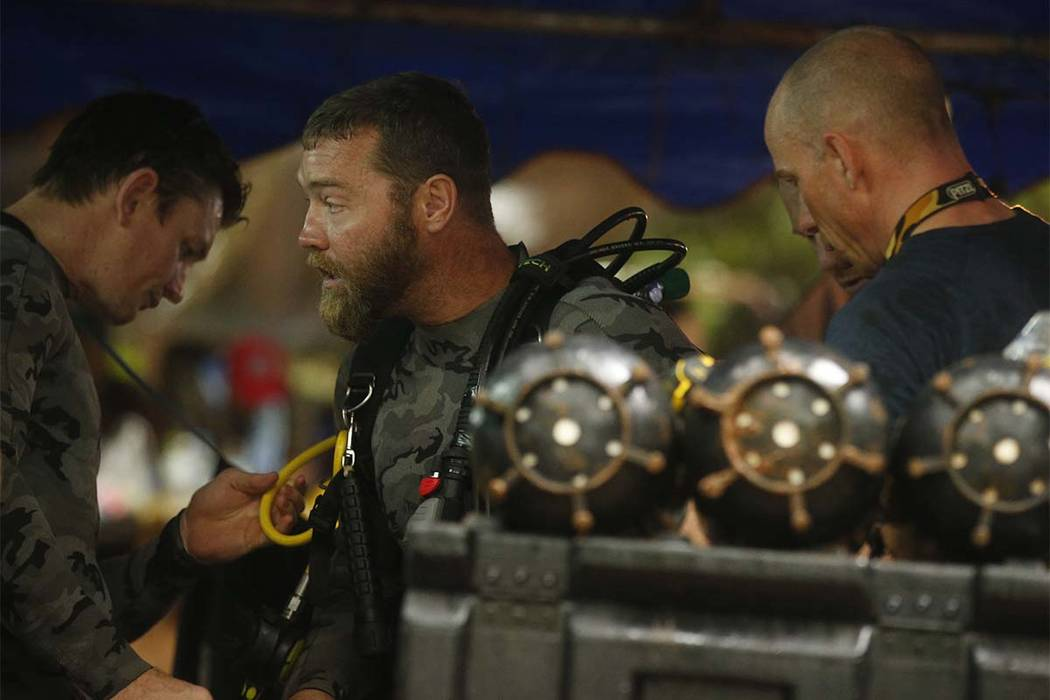 Australian Federal Police and Defense Force personnel prepare for diving after the 12 boys and their soccer coach were found alive, in Mae Sai, Chiang Rai province, in northern Thailand, Tuesday, ...