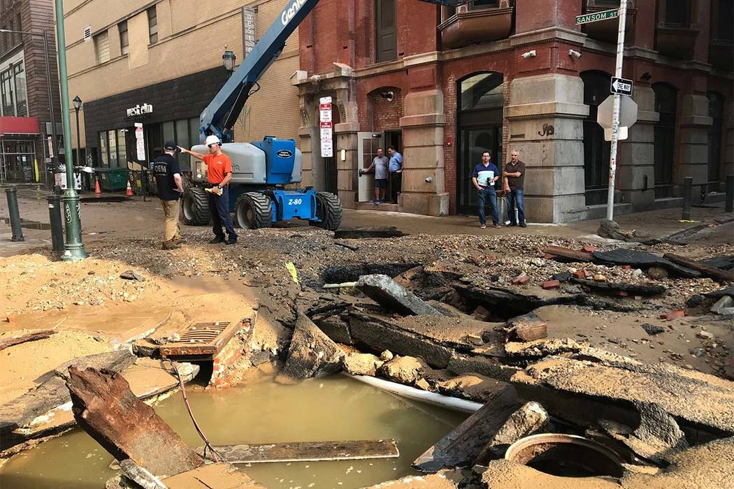 Philadelphia Water Department personal work in Philadelphia where a water main break occurred early Tuesday, July 3, 2018. The break happened before 4 a.m. Tuesday, and a number of center city str ...