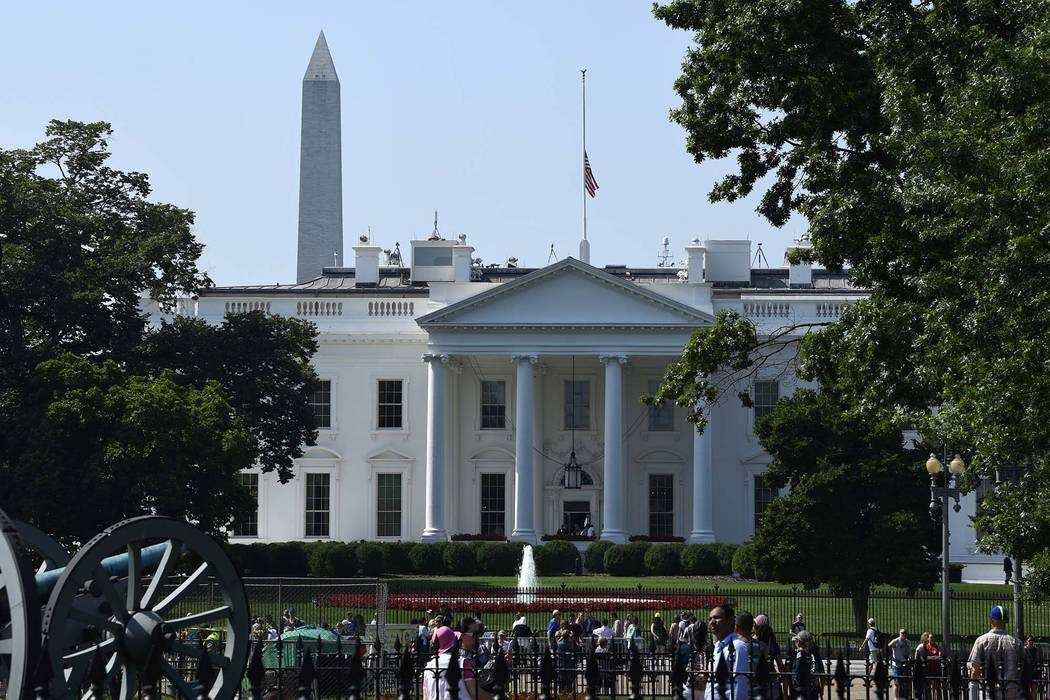 The flag of the United States flies at half-staff over the White House in Washington, Tuesday, July 3, 2018, to honor the five people killed in the Annapolis, Maryland, shooting at the Capital Gaz ...