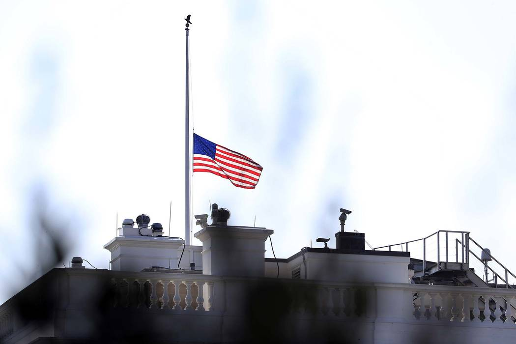 The United States flag is lowered at half-staff at the White House in Washington, Tuesday, July 3, 2018, to honor the victims killed in the June 28th shooting at the Capital Gazette newspaper in A ...