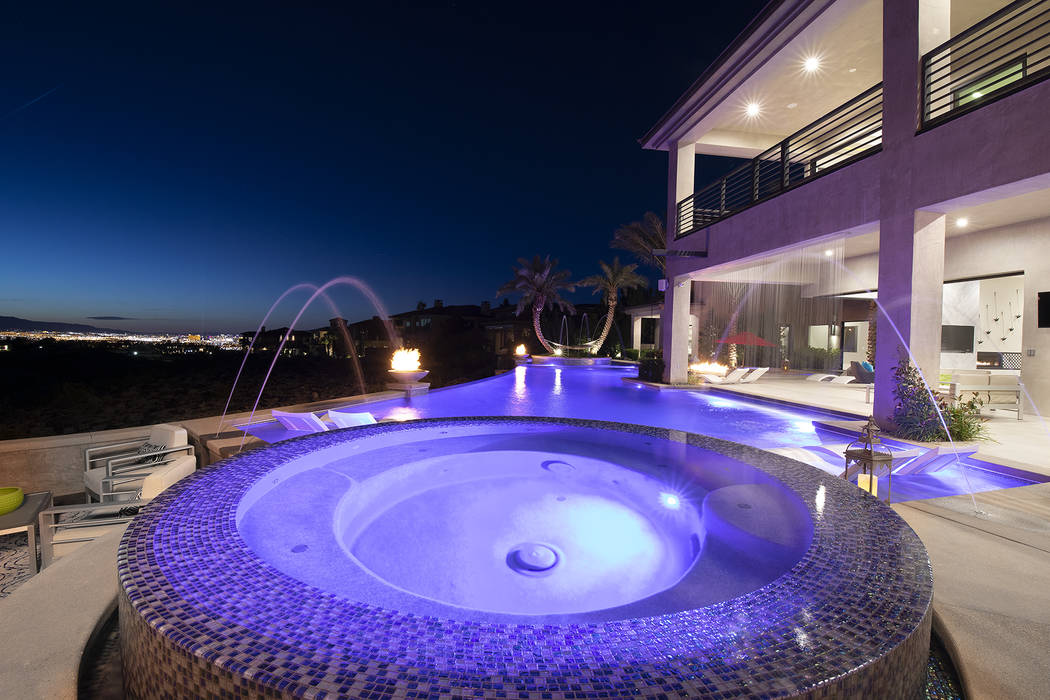The home has a cascading waterfall leading to the spa area. (Sotheby's International Realty)