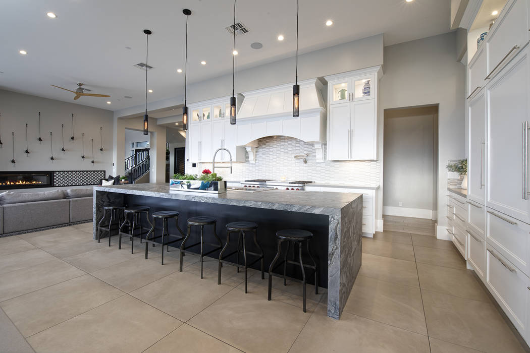 The kitchen has a large island with seating. (Sotheby's International Realty)