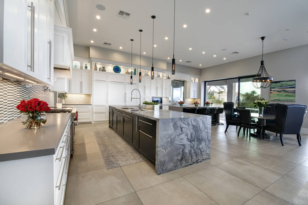 The kitchen has a second large island. (Sotheby's International Realty)
