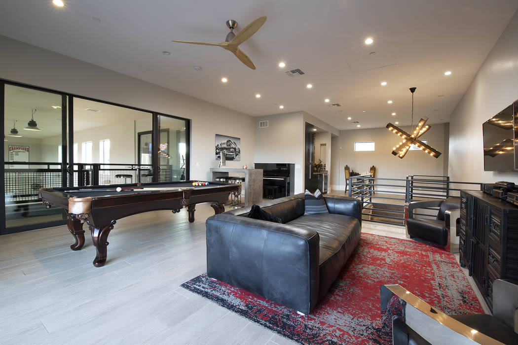 The game room overlooks the basketball court. (Sotheby's International Realty)