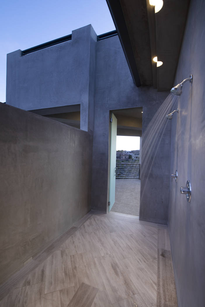 The pool area has outdoor showers. (Sotheby's International Realty)