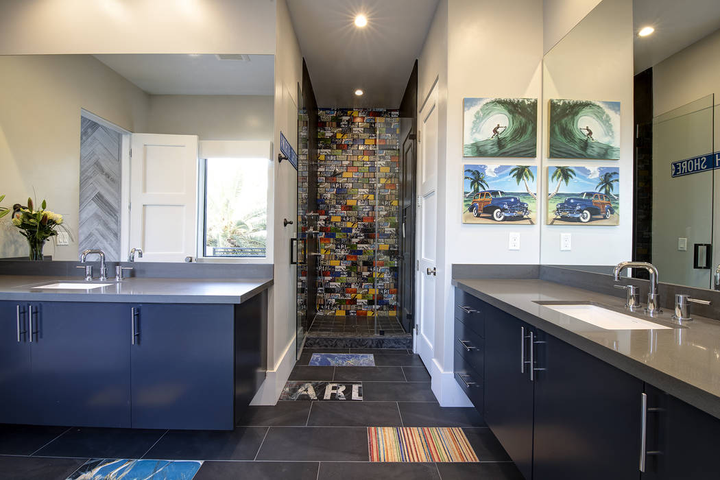 A secondary bath has colorful shower tile. (Sotheby's International Realty)