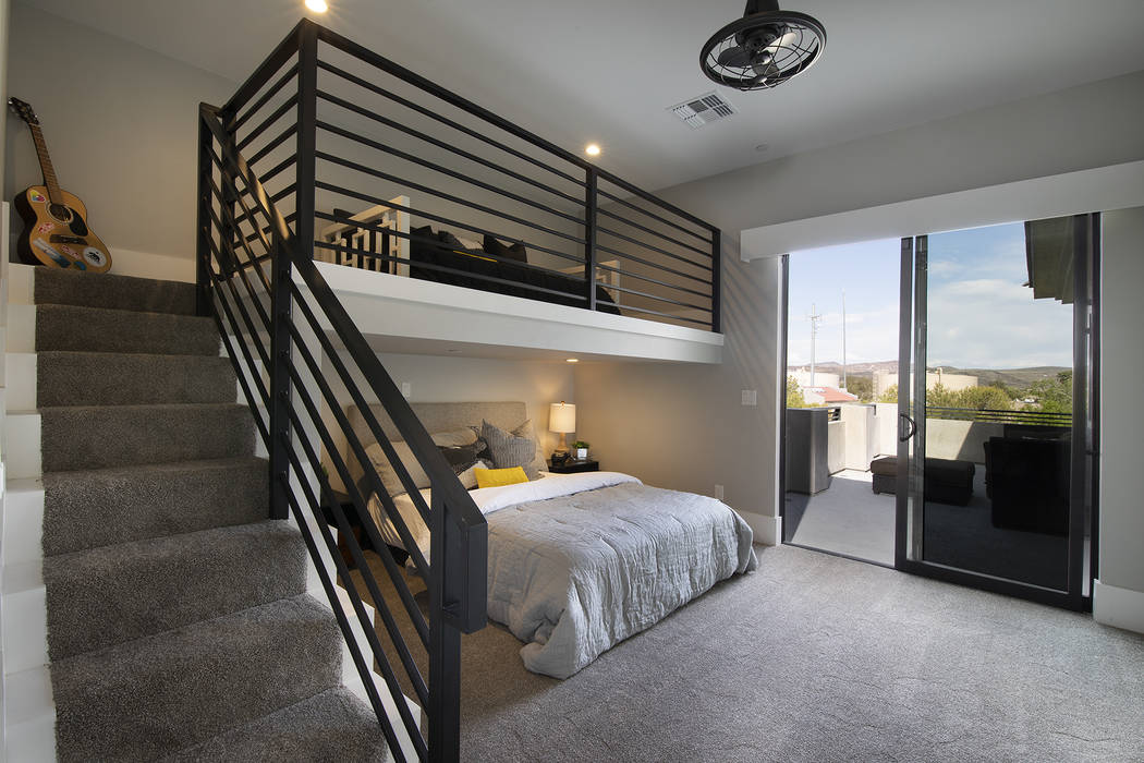 A loft and bedroom has a balcony. (Sotheby's International Realty)