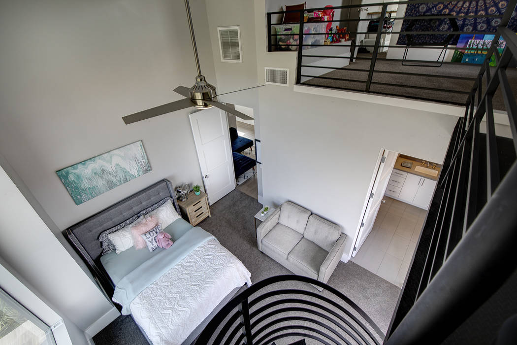 Stairs connects a loft and a bedroom. (Sotheby's International Realty)