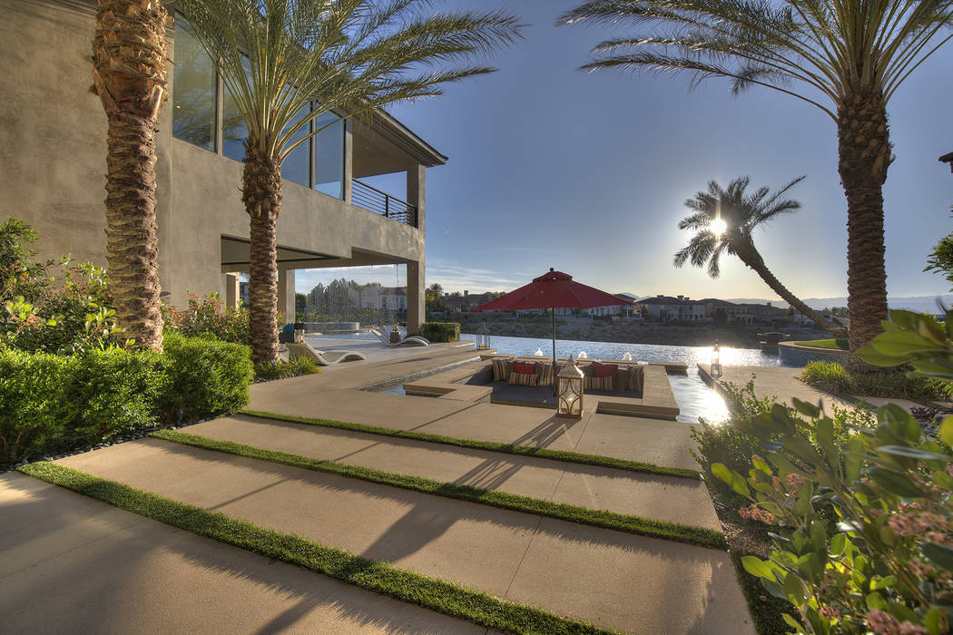 The pool has a sunken seating area. (Sotheby's International Realty)
