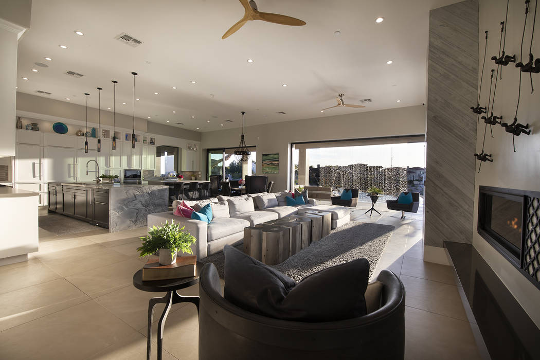 The kitchen and great room open to a pool area under a cascading waterfall. (Sotheby's International Realty)