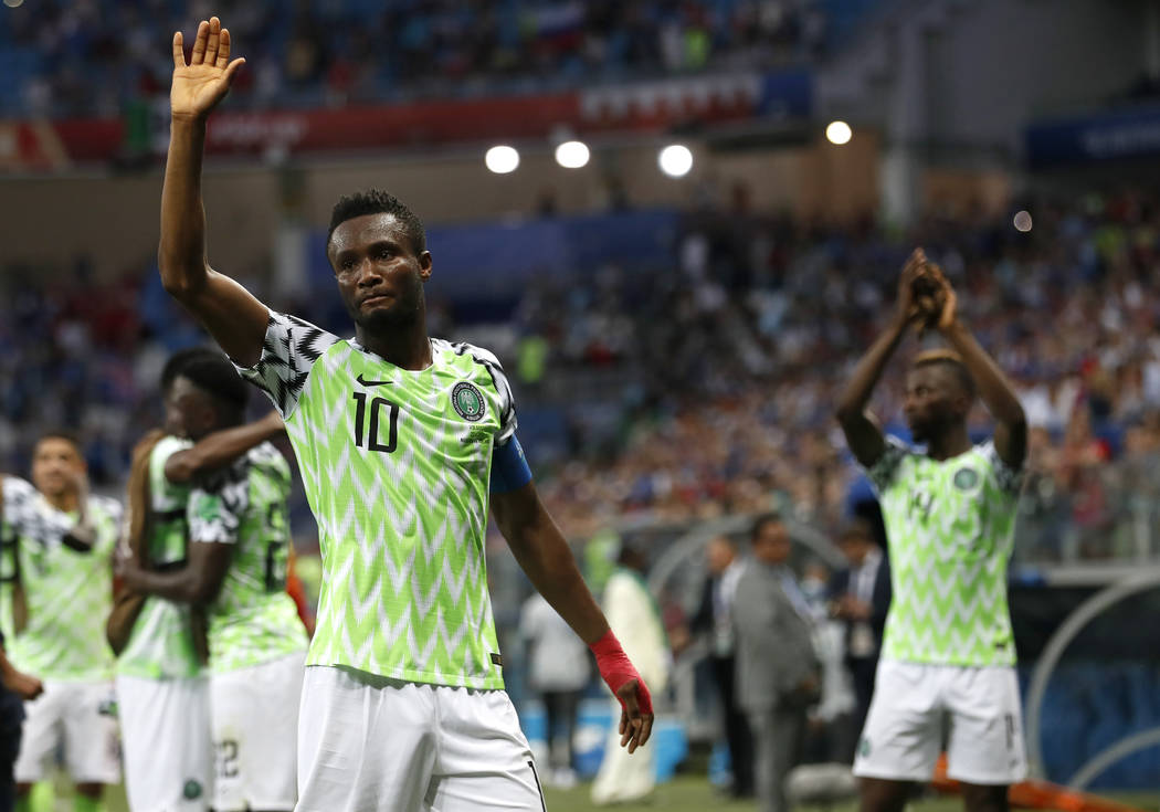 In this June 22, 2018 file photo, Nigeria captain John Obi Mikel waves to his team's supporters after their 2-0 win in Group D over Iceland at the World Cup in Volgograd, Russia. (AP Photo/Darko V ...