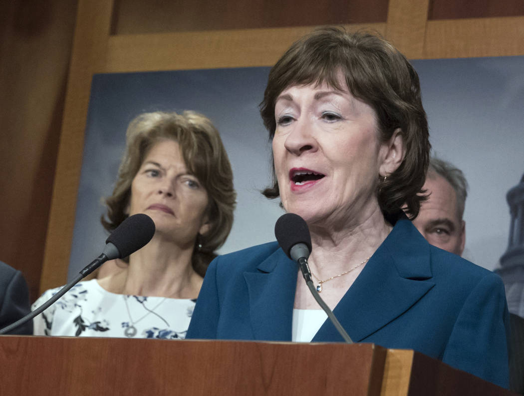 Sen. Susan Collins, R-Maine and Sen. Lisa Murkowski, R-Alaska, left, are shown during a news conference at the Capitol in Washington, Feb. 15, 2018. (J. Scott Applewhite/AP)