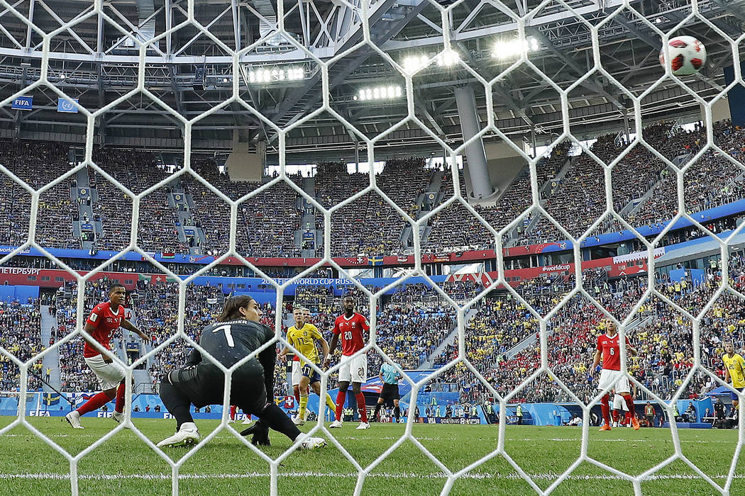 Switzerland goalkeeper Yann Sommer looks round as a deflected shot from Sweden's Emil Forsberg goes into the net for the opening goal during the round of 16 match between Switzerland and Sweden at ...