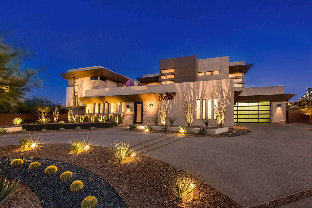 Blue Heron Sage Design Studios designed the outdoor lighting to highlight the plants at this house.