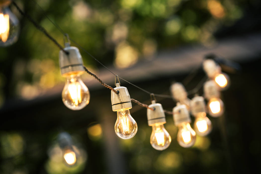 Thinkstock String lights hang on a line in the backyard.