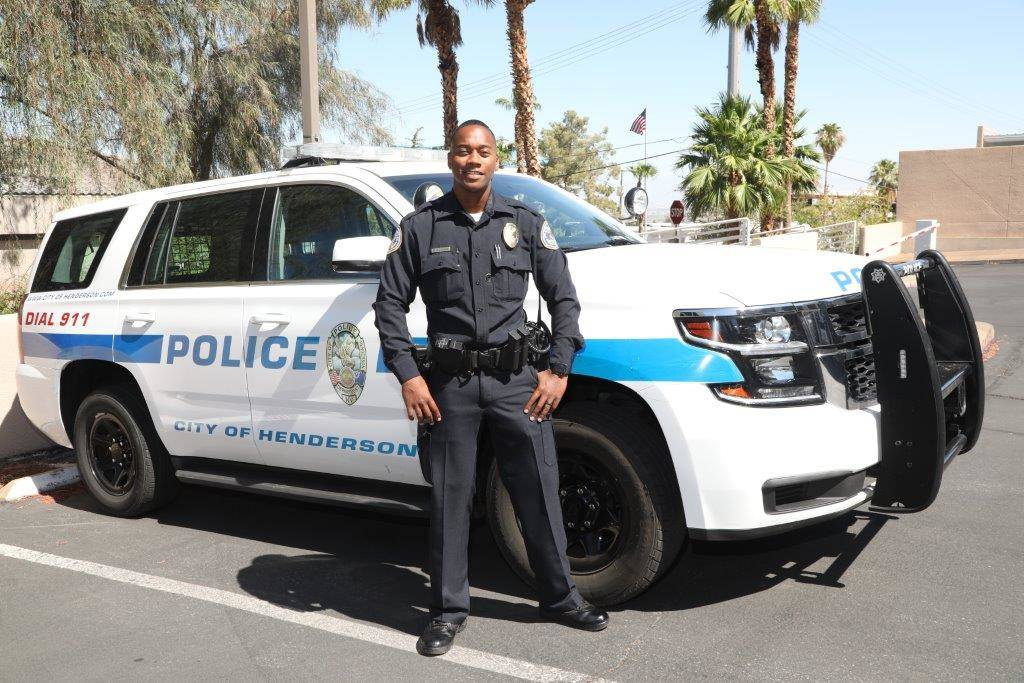 Henderson officer E. Duncan poses in front of his patrol vehicle after placing his body-worn camera into place on his uniform. The cameras are part of a newly integrated system required by Senate ...