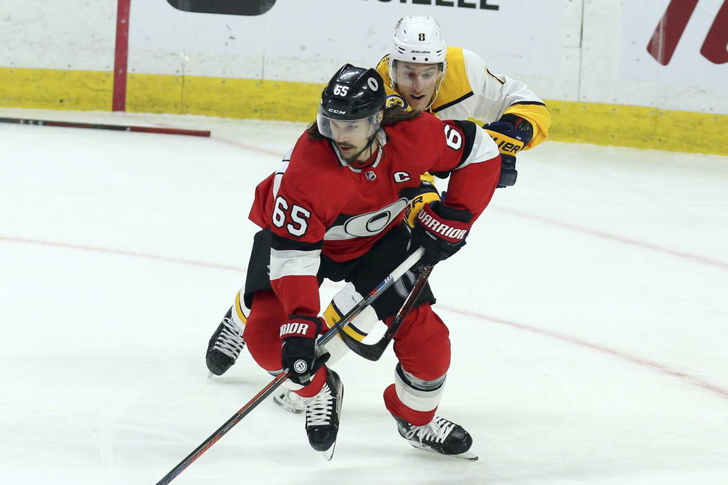 In this Feb. 8, 2018, file photo, Ottawa Senators' Erik Karlsson (65) is chased by Nashville Predators Kyle Turris (8) during first-period NHL hockey game action in Ottawa, Ontario. (Fred Chartran ...