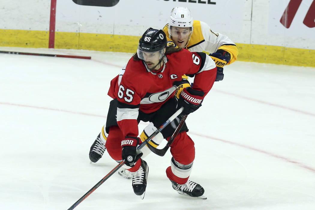 In this Feb. 8, 2018, file photo, Ottawa Senators' Erik Karlsson (65) is chased by Nashville Predators Kyle Turris (8) during first-period NHL hockey game action in Ottawa, Ontario. (Fred Chartran ...