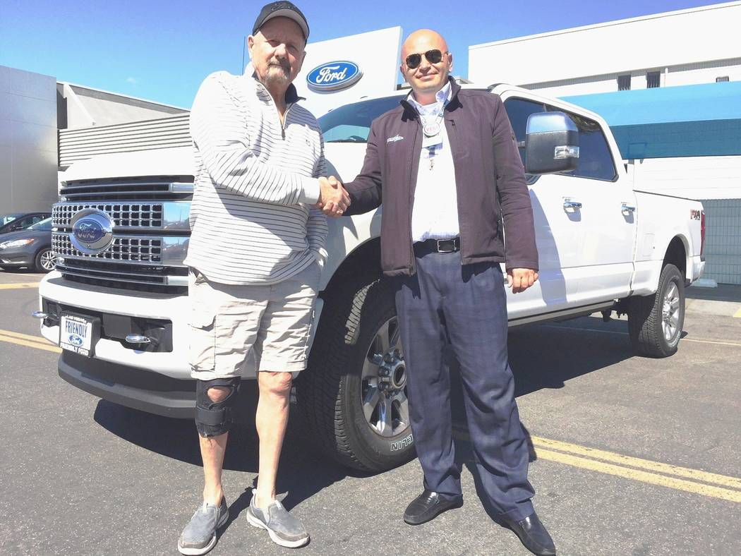 Friendly Ford Pahrump resident Tom Triol, left, is seen with his 2018 Super Duty Platinum Edition truck at Friendly Ford. He bought the truck from Friendly Ford product trainer Grig Demirchyan.