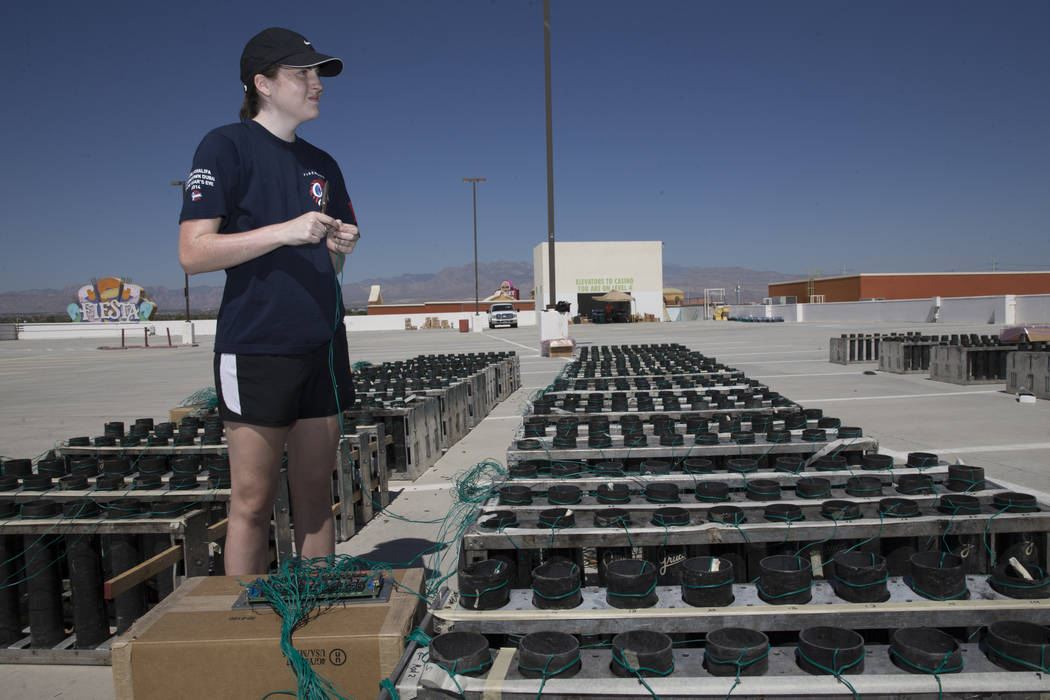 Brittany Zastrow, pyrotechnician with Fireworks by Grucci, connects wiring for a Fourth of July firework show at the Fiesta Rancho casino-hotel in Las Vegas, Tuesday, July 3, 2018. Erik Verduzco L ...