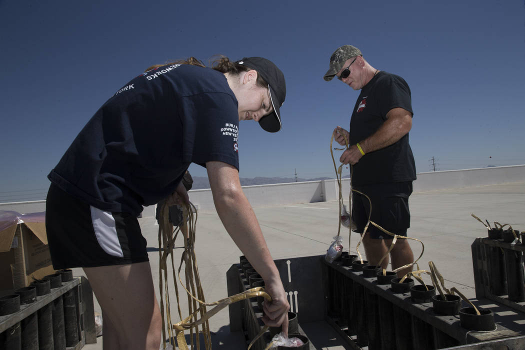 Brittany Zastrow, left, and Tom Williams, pyrotechnicians with Fireworks by Grucci, prepare for a Fourth of July firework show at the Fiesta Rancho casino-hotel in Las Vegas, Tuesday, July 3, 2018 ...