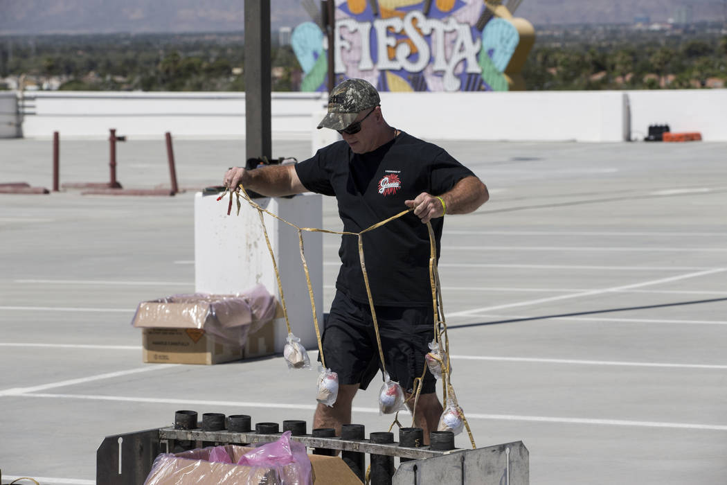 Tom Williams, pyrotechnician with Fireworks by Grucci, prepares for a Fourth of July firework show at the Fiesta Rancho casino-hotel in Las Vegas, Tuesday, July 3, 2018. Erik Verduzco Las Vegas Re ...