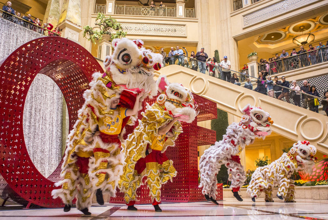 """Members of Yau Kung Moon Kung Fu Dragon and Lion Dance perform a traditional lion dance to celebrate the Chinese New Year and the start to the """"Year of the Dog"""" at The Venetian in Las Ve ..."""