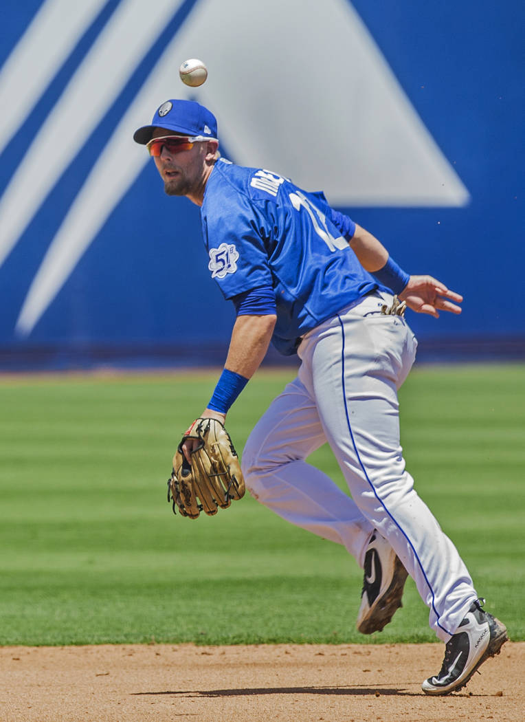 51s second baseman Jeff McNeil (12) makes a behind-the-back play during Las Vegas' home matchup with the Reno Aces on Sunday, June 24, 2018, at Cashman Field, in Las Vegas. Benjamin Hager Las Vega ...