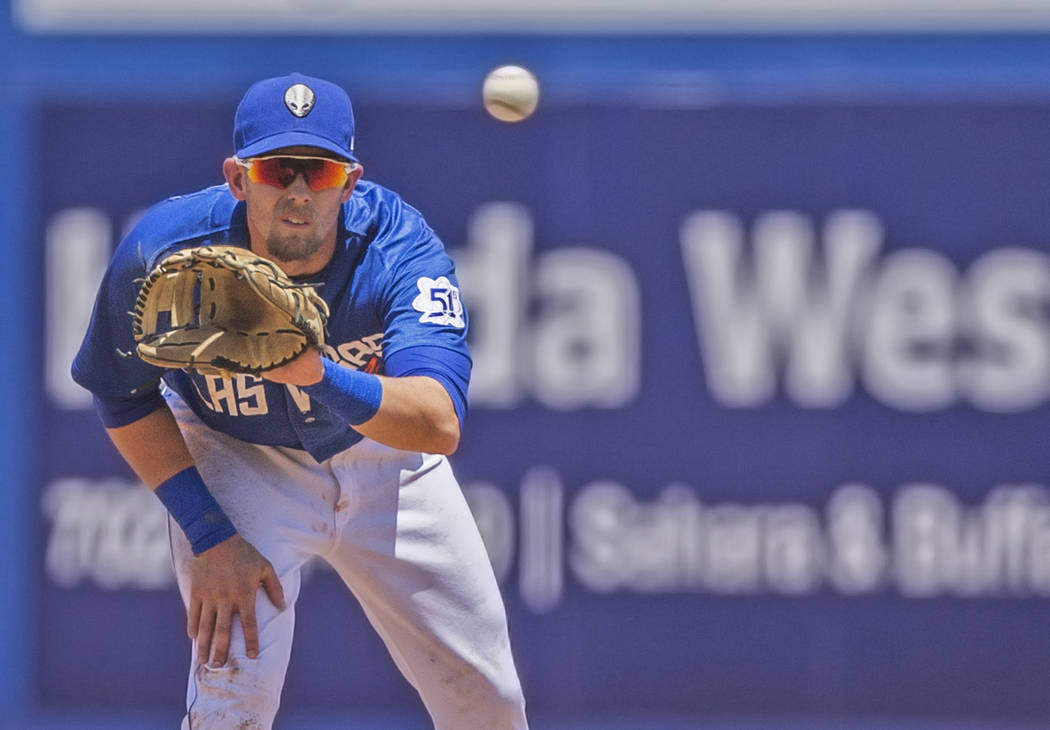 51s second baseman Jeff McNeil (12) makes a catch during Las Vegas' home matchup with the Reno Aces on Sunday, June 24, 2018, at Cashman Field, in Las Vegas. Benjamin Hager Las Vegas Review-Journa ...