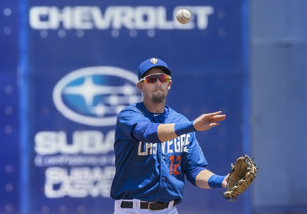 51s second baseman Jeff McNeil (12) throws out a runner during Las Vegas' home matchup with the Reno Aces on Sunday, June 24, 2018, at Cashman Field, in Las Vegas. Benjamin Hager Las Vegas Review- ...