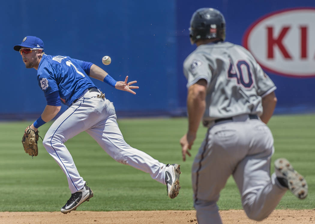 51s second baseman Jeff McNeil (12) makes a behind-the-back play to retire Reno Aces Anthony Recker (40) on Sunday, June 24, 2018, at Cashman Field, in Las Vegas. Benjamin Hager Las Vegas Review- ...
