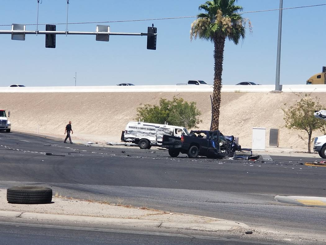 A white van and a pickup truck involved in a multivehicle crash are seen on Boulder Highway at U.S. Highway 95 on Tuesday, in Las Vegas. (Crystal Hickman)