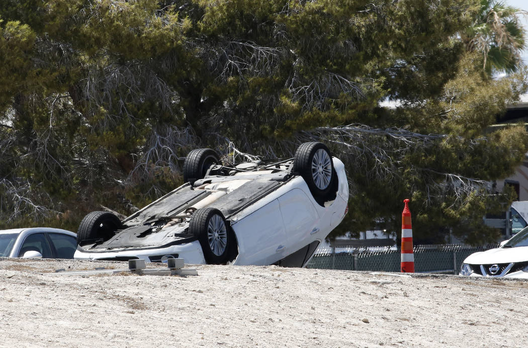 A flipped car involved in a multivehicle crash is seen on Boulder Highway at U.S. Highway 95 on Tuesday, in Las Vegas. Bizuayehu Tesfaye/Las Vegas Review-Journal @bizutesfaye