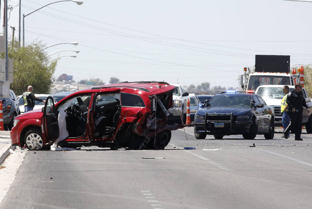 An SUV involved in a multivehicle crash is seen on Boulder Highway at U.S. Highway 95 on Tuesday, in Las Vegas. Bizuayehu Tesfaye/Las Vegas Review-Journal @bizutesfaye