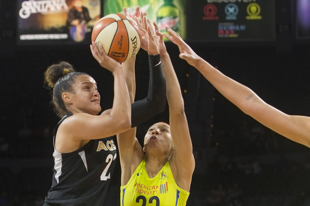 Aces guard Kayla McBride (21) drives past Dallas Wings forward Aerial Powers (23) in the 4th quarter on Wednesday, June 27, 2018, at the Mandalay Bay Events Center, in Las Vegas. Benjamin Hager La ...