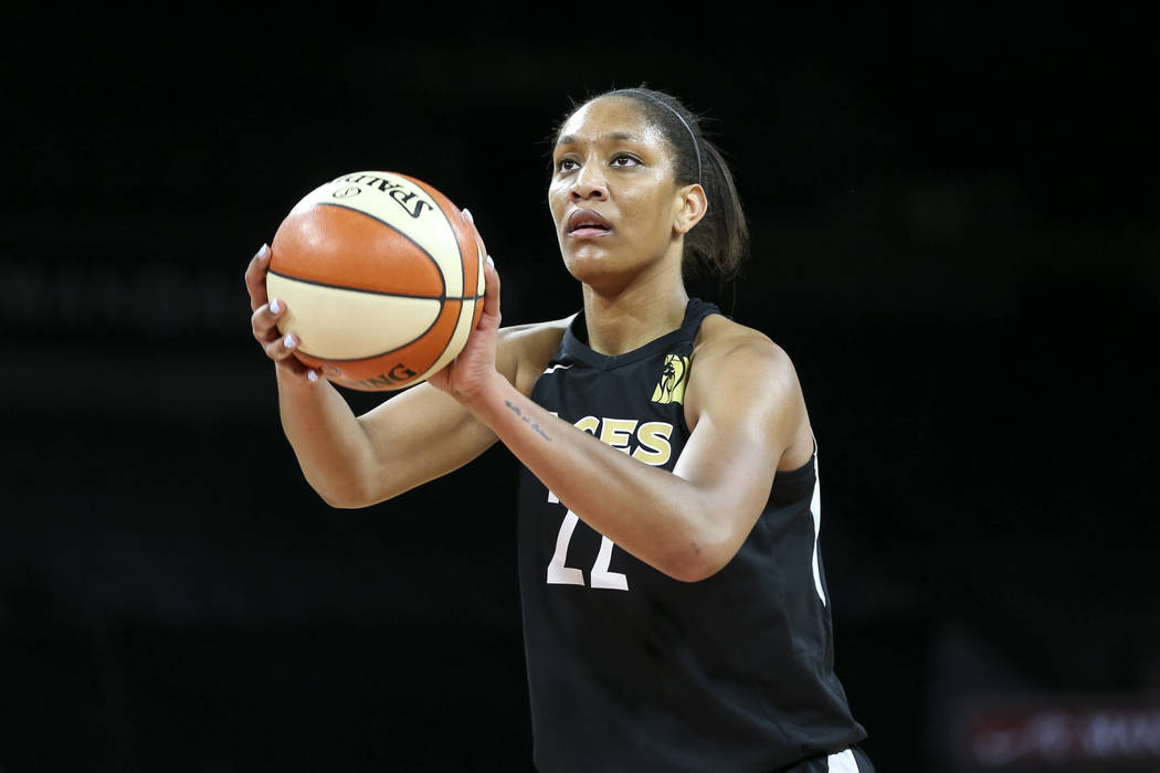 Las Vegas Aces center A'ja Wilson (22) shoots a free throw against the Los Angeles Sparks in the second half of a WNBA basketball game at the Mandalay Bay Events Center in Las Vegas on Friday, Jun ...
