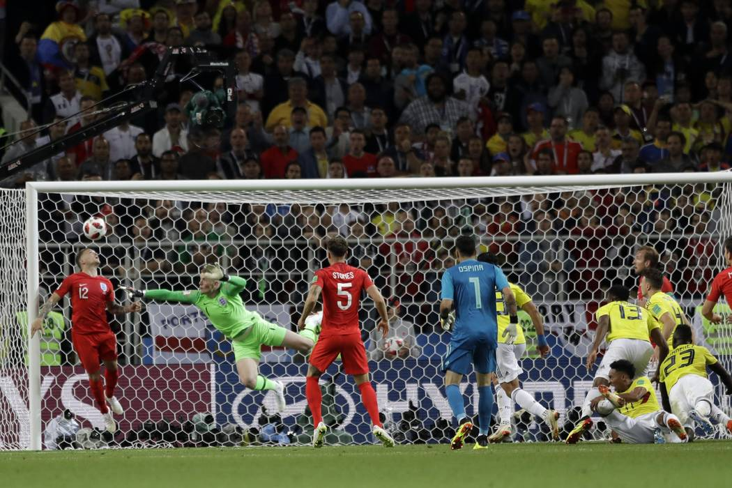 Colombia's Yerry Mina (13) scores his side's first goal during the round of 16 match between Colombia and England at the 2018 soccer World Cup in the Spartak Stadium, in Moscow, Russia, Tuesday, J ...