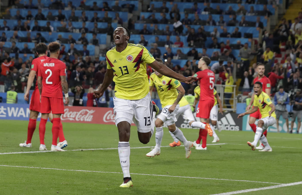 Colombia's Yerry Mina celebrates after scoring his first side's goal during the round of 16 match between Colombia and England at the 2018 soccer World Cup in the Spartak Stadium, in Moscow, Russi ...