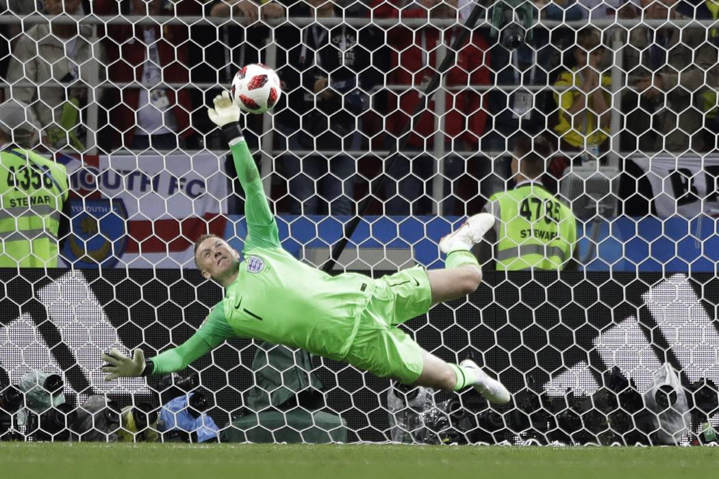 England goalkeeper Jordan Pickford saves a penalty during the round of 16 match between Colombia and England at the 2018 soccer World Cup in the Spartak Stadium, in Moscow, Russia, Tuesday, July 3 ...