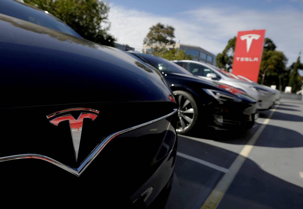 FILE PHOTO: A Tesla Model X is seen alongside a Model S at a Tesla electric car dealership in Sydney, Australia May 31, 2017. REUTERS/Jason Reed/File Photo