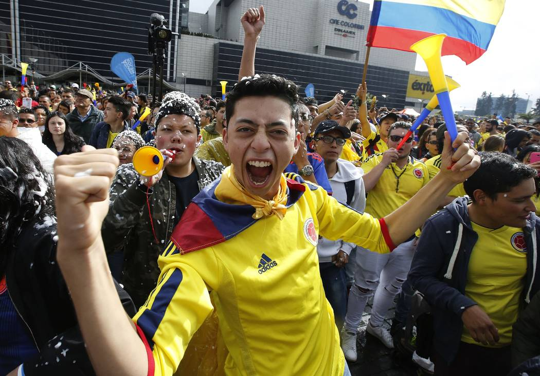 Colombian fans watch an outdoor live telecast of the 2018 soccer World Cup match between Colombia and England, in Bogota, Colombia, Tuesday, July 3, 2018. England won the match in a penalty shooto ...