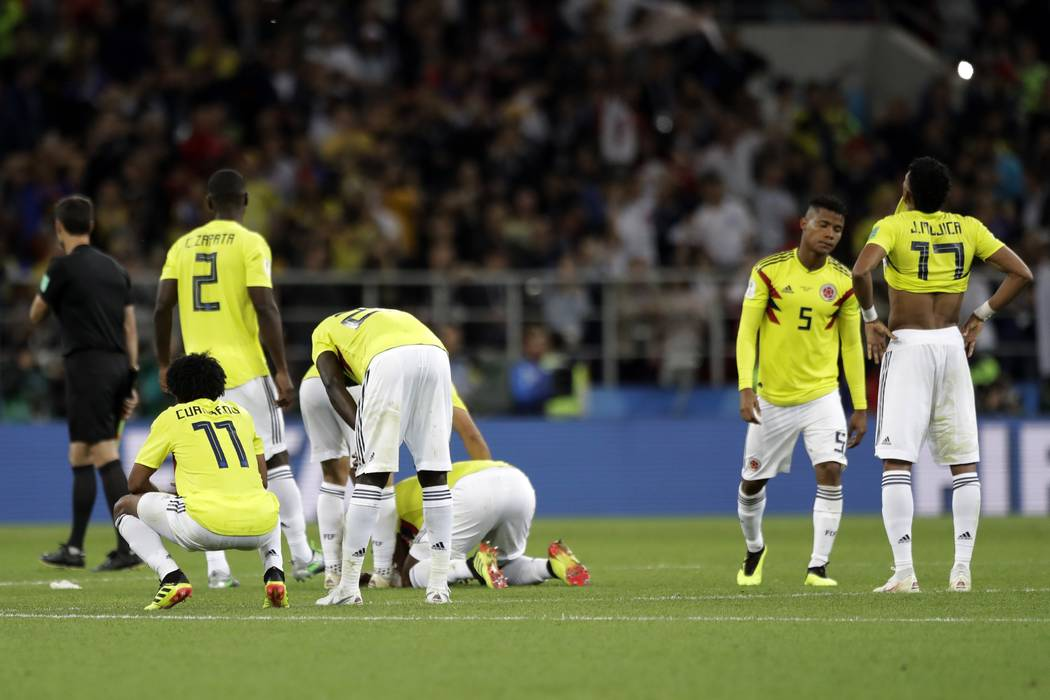 Colombia players react after the round of 16 match between Colombia and England at the 2018 soccer World Cup in the Spartak Stadium, in Moscow, Russia, Tuesday, July 3, 2018. England eliminates Co ...