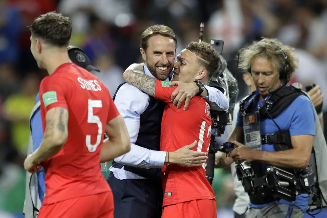 England head coach Gareth Southgate, center, hugs Kieran Trippier after the round of 16 match between Colombia and England at the 2018 soccer World Cup in the Spartak Stadium, in Moscow, Russia, T ...