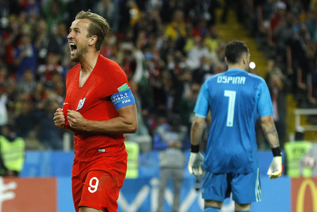 England's Harry Kane celebrates after scoring his side's first goal during the round of 16 match between Colombia and England at the 2018 soccer World Cup in the Spartak Stadium, in Moscow, Russia ...
