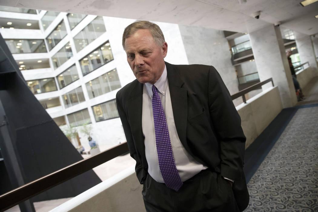 Senate Intelligence Committee Chairman Richard Burr, R-N.C., goes behind closed doors as members of the Senate Intelligence Committee arrive to vote on Gina Haspel, President Donald Trump's pick t ...